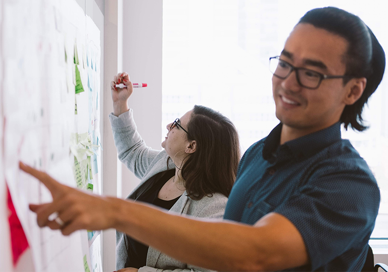 User Experience Designers at a whiteboard